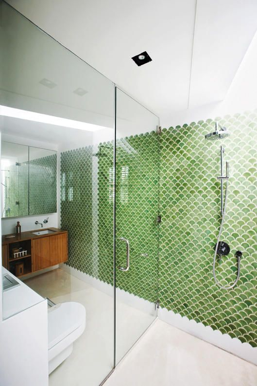 ike mermaid scales, green encaustic wall tiles decorate the bathroom and bring a seaside resort feel the master bathroom.bathroom, home, master bedroom, ensuite, singapore, shophouse