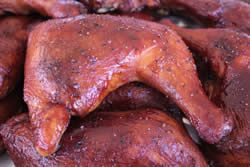 Complete instructions with pictures for makingds delicious, juicy and tender smoked chicken quarters glazed with my beer barbecue glaze.
