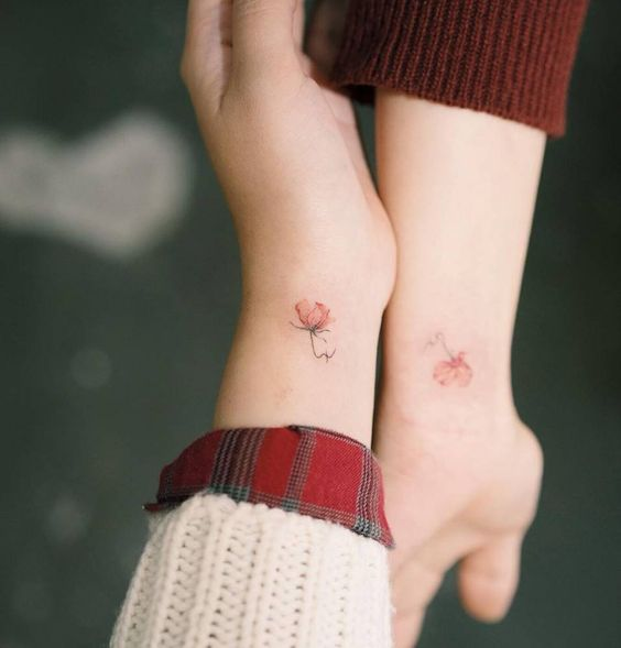 Matching initials (SC) + flower tattoo on the wrists. Tattoo artist: Sol Tattoo: