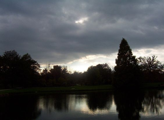 dark-clouds-over-pond-110661300194847ZXW