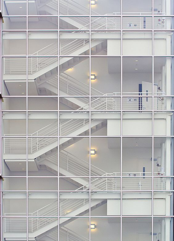 Clean Steel Stairs With Minimal Stick Built Curtain Wall