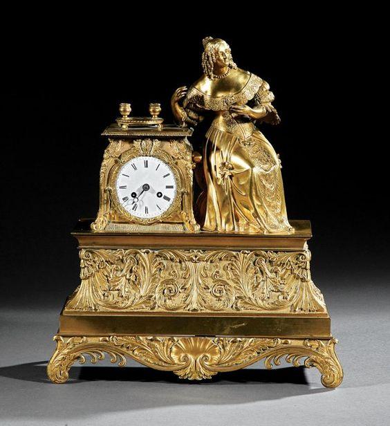A Napoleon III Gilt Bronze Figural Mantel Clock