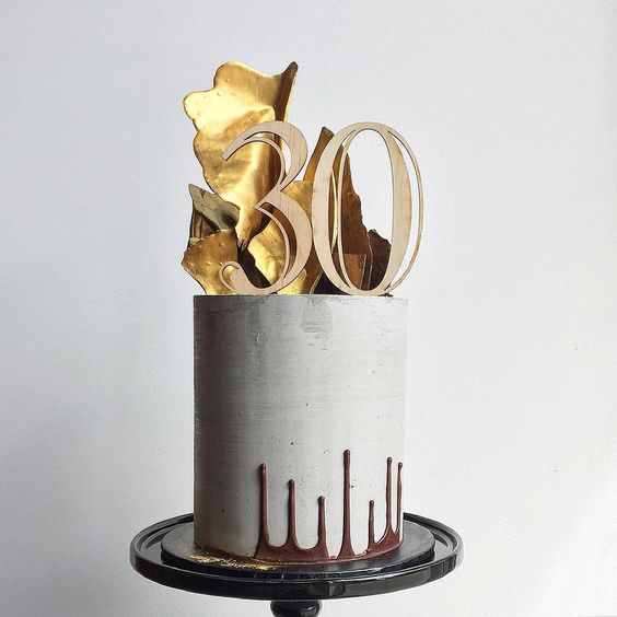 """Don't tell Charles. """"Tried my hands at the @cakesbycliff upside down drip. The flip was so nerve wracking lol. Topper by @glisteningoccasions_ #concrete #concretecake #gold…"""""""