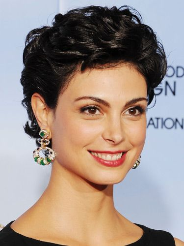 A sky-high styling means that dainty TV star Morena Baccarin gets a vertical boost. Manicure arches also help to anchor stronger statement looks, like this one