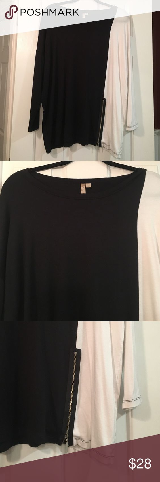 "New Comfy brand B & W zip tunic top New Comfy brand black and white tunic top with zipper at bottom left front size medium. Super soft top with nice stretch. Wide crew neck and loose fit. 92% modal and 8% spandex. 28"" length and 24""'chest. Comfy brand  Tops Tunics"