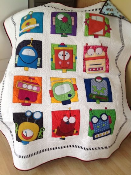 Chris made this for her grandson from Amy Bradley Designs Robots quilt pattern, love it!