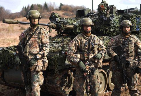 Lt Gen Darryl Williams speaks with Latvian sol rs during