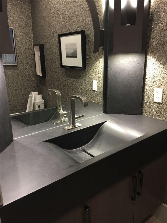 custom built jet black concrete bathroom vanity with an integrated