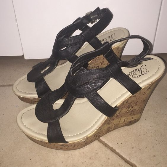 cute black wedges  size tag has worn off, but pretty sure they are a 7 1/2. I am a 7 1/2 and they fit me perfectly. Just bought a new pair of black wedges so its time to sell this pair! fusion Shoes Wedges