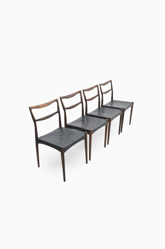 HW Klein chairs in palisander produced by Bramin, more HW Klein chairs and mid century chairs at Studio Schalling
