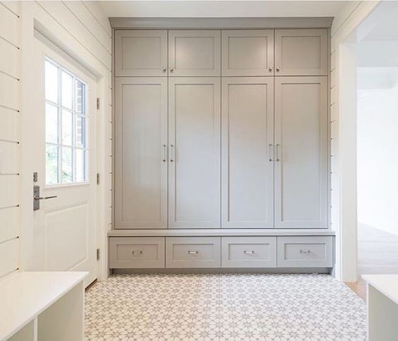 A beautiful mud room with built-in cabinetry, cement tile flooring, and shiplap walls. Design by Bria Hammel Interiors. #mudroom #cementtiles #Scandinavian #lightgrey