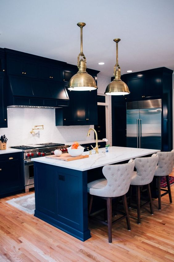 "Black Blue by Farrow & Ball. ""The homeowners wanted something classic but (which) still made a statement,"" she says, ""but they were adamant that they did not want a black-and-white kitchen. Navy acts as a neutral and can achieve that same bold look without going over the top."""