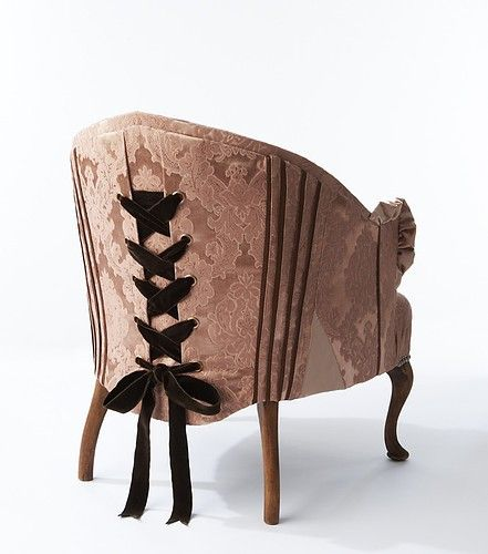 pink corset chair. utterly ridiculous, yet so incredibly fabulous. imagine a manly man sitting in this chair. :)