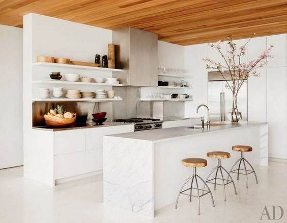 Airy and organic is the name of the game in this kitchen. Subtle gray veining on the kitchen island is the subtlest of statements.