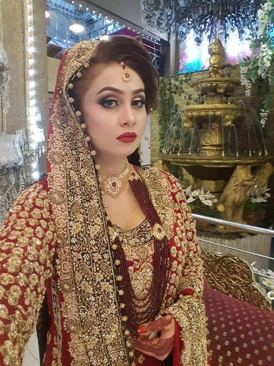 Stunning red with golden lehngas for brides