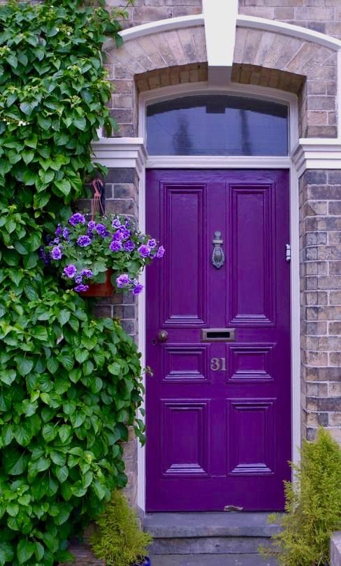 Brightly colored doors with stylish door knockers are a great way to make a statement with your home's exterior! This bright purple door and matte brass door knocker are stunning and bring out the purple in the surrounding brick. Check out this blog for more door color and knocker combinations.