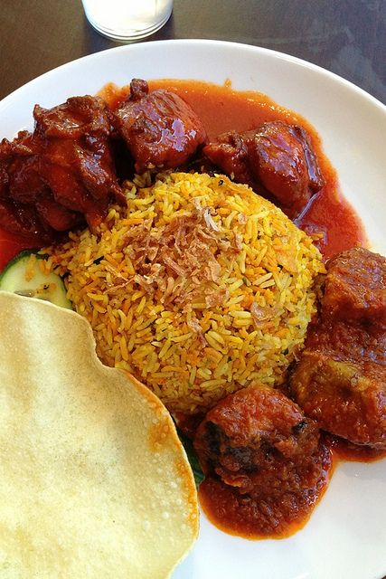 Yummy nasi briyani! Nasi Briyani is an indian cuisine of flavored steam rice that is usually served with pickled vegetables, papadom and also chicken or mutton covered in curry which can be found in all Indian Muslim foodstalls throughout Malaysia