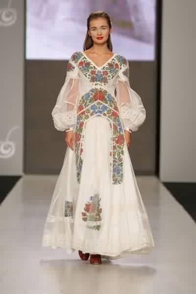 Wedding dress by ukrainian designer roksolana bogutska new fabrics meld with traditional design - Traditional style wedding romania ...