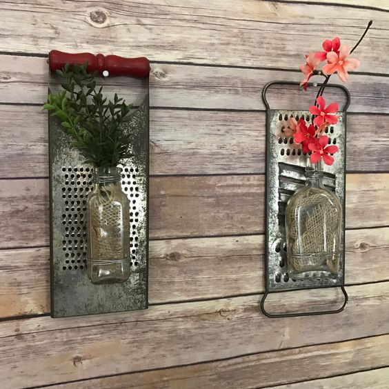 repurposed cheese graters made into wall decor.