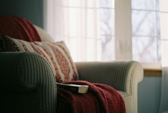 love comfy chairs, blankets, pillows, and a good book to read.