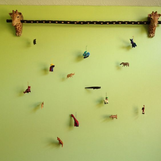 Nice idea for a kids room. Hang figures with fishing line to decorate the wall.