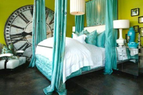 Turquoise with green. Vivid colours paired with vintage style furniture. Love the giant clock.