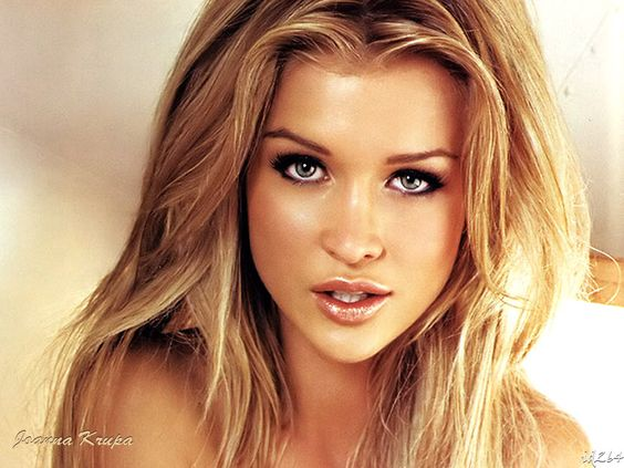 Joanna Krupa. Totally airbrushed, but love the makeup and hair