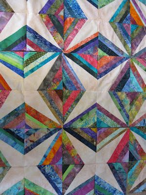 Love the batiks in this quilt, very pretty colors. Lots of free patterns at this site - maryquilts.com.: