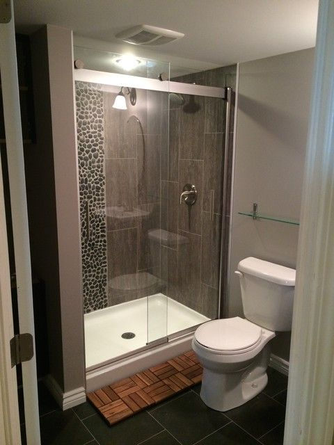 A Large Mirror Over The Sink Reflects Both The Window On The Opposite Wall And The Pendant Lights Bou Basement Bathroom Design Basement Bathroom Bathroom Cost