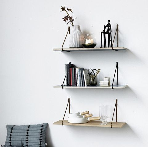Wooden shelf with iron hanger. A stylish way to display books, ornaments and more.