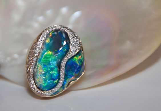 Our submission for the 2013 @AGTA Spectrum Awards. Ladies Black Opal and Diamond ring, 18k yellow gold, 24.28 carat  Free form Black Opal from Lightning Ridge Australia accented with (110) Round Brilliant cut Diamonds weighing .70 carats. Designed by John Ford, manufactured on site at John Ford Jewelers in Galveston, TX