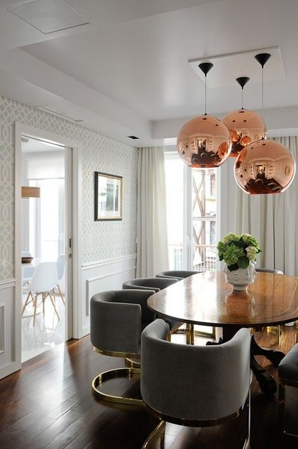 rose gold ceiling lights + wood table in dining room: