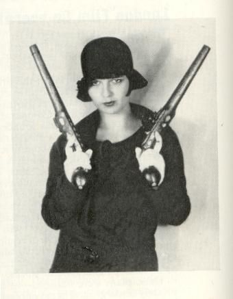 pow. Louise Brooks and her big guns