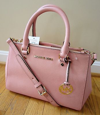 Pale pink leather handbags
