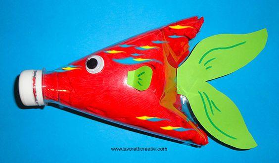 PESCE CON BOTTIGLIA DI PLASTICA Pesce tropicale creato con materiale di riciclo da fare insieme ai bambini durante in periodo delle vacanze estive. Pesce t