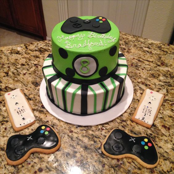 XBox and Wii chocolate cake with raspberry filling and almond cake. Wii and XBox remote control sugar cookies. https://www.facebook.com/sweetnsassycakesbyeva