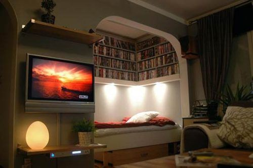 Would love to have that book shelf full of books above my bed