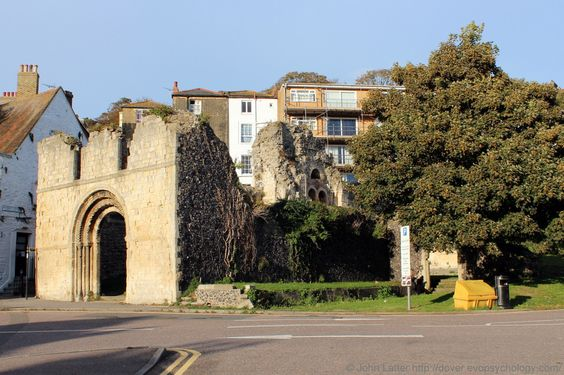 Old St James Church War Memorial, Dover, Kent, England, United Kingdom. The church of St James the Apostle was destroyed in World War II, ruins now a monument to the people of Dover UK who endured bombs and shell-fire 1939-1945. West Door (left) and North Tower (centre). 14th Century White Horse Inn separated from the church by Hubert Passage to the left; churchyard, or cemetery once extended to the right. Urban, History, Architecture, and Religion. See…