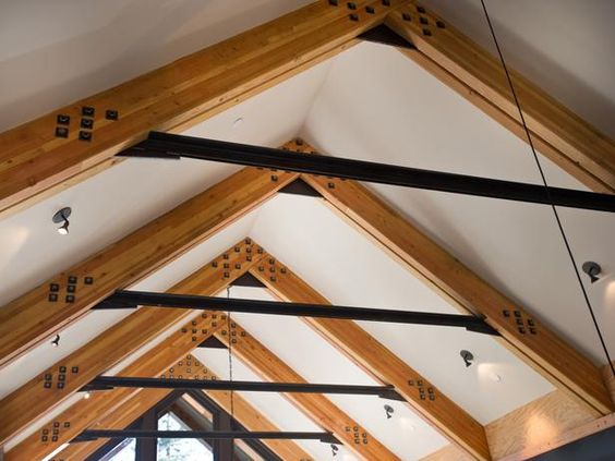 Exposed Glulam Beams ~ Glue laminated wood beams connected one another with steel