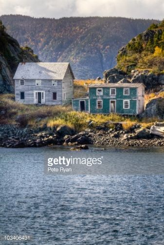 Stock Photo : Abandoned, historic salt box homes (c. 1900) in a fishing outport.