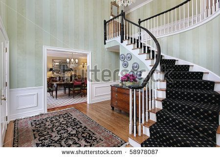 stock photo : Foyer in luxury home with carpeted staircase