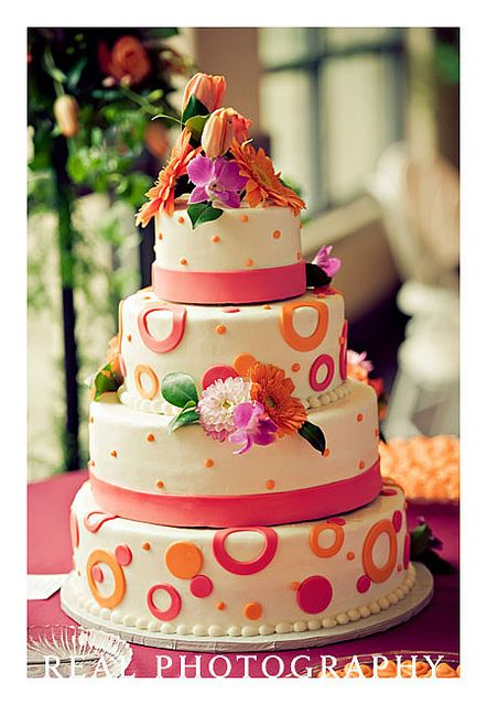 modern white pink and orange wedding cake with circles and polka dots by Traci Turchin, via Flickr