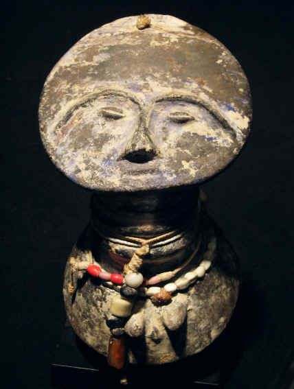 This is such a gorgeous fertility statue.    I love them.      Ashanti terracota head , with glass beads, and some blue and white pigments