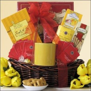 Elenni Tea Treasures ~ Small: Gourmet Tea Gift Basket TES  Send this delightful tea basket filled with a nice assortment of cookies, teas and delicious honey. Includes a vary of Stash Premium Teas, Honey Sticks, and much more.  Includes:  Lindt White Chocolate Truffle ~ 1 pc.   Anna's Gourmet Cinnamon Flavored Honey Sticks ~ 1.8 oz. 2 of them   Too Good Gourmet Cinnamon English Tea Cookies ~ 7 oz.   and so much more,,,,,