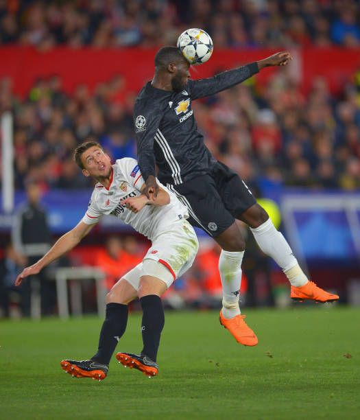 Clement Lenglet Of Sevilla In Action With Romelu Lukaku Of Manchester United During The Uefa Champions League Round Of 16 Manchester United Manchester The Unit