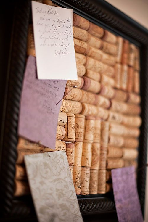 Pin board of corks from all the wine bottles opened for the wedding, with guest notes written at the wedding.