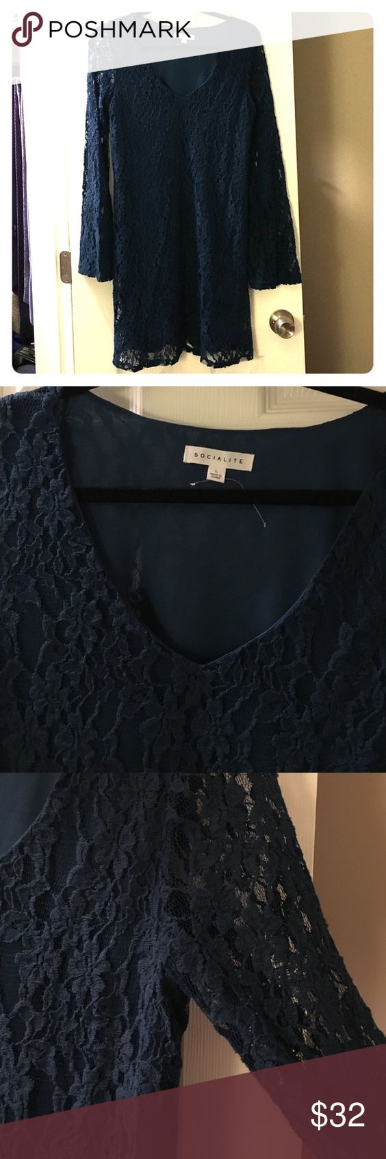 Cute blue lace minidress! NWOT NWOT never worn! Cute navy blue long sleeved lace dress. See thru arms. SOCIALITE Dresses
