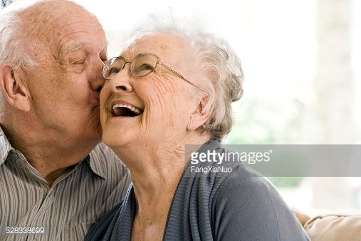Stock Photo : Elderly Man and Woman on Couch in Nursing Home