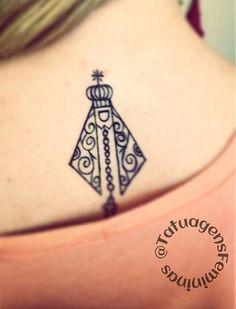 Tatuagem nas costas de N. Senhora Aparecida: