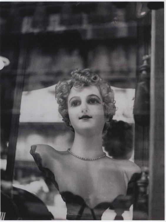 "Dora Maar, ""Model in the window"", Paris, 1933. Doll pretending to be a woman and woman pretending to be a doll"